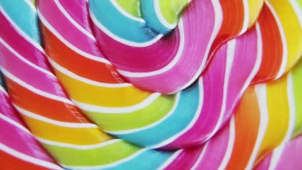 Thumbnail for Background of Striped Spiral Multicolor Lollipop