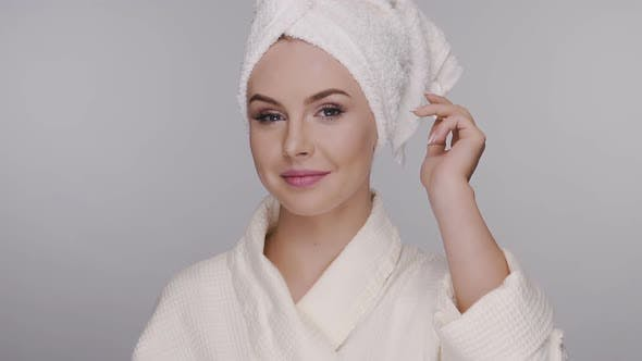 Thumbnail for Pretty Girl in Bathrobe and Bath Towel Applying Cream on Face