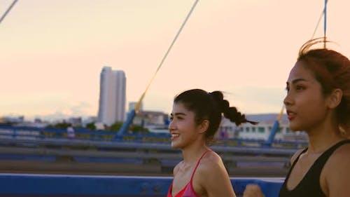 Healthy Female Friends Jogging