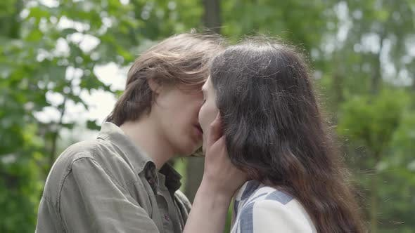 Thumbnail for Portrait of Young Couple Tenderly Kissing Close Up