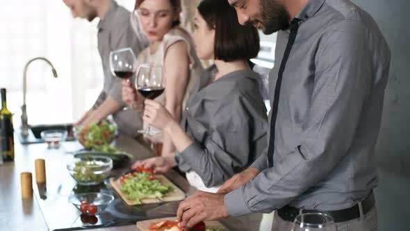 Thumbnail for Middle Eastern Man Cooking with Friends and Smiling for Camera