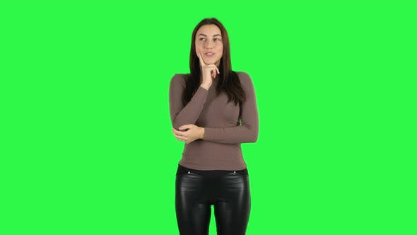 Cover Image for Attractive Girl Waiting in Anticipation with Pleasure. Green Screen