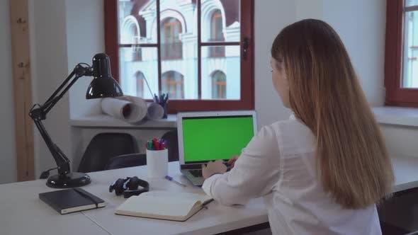 Thumbnail for Businesswoman Entering Data on Laptop