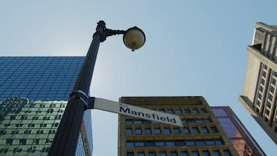Light pole with street signs, in Montreal