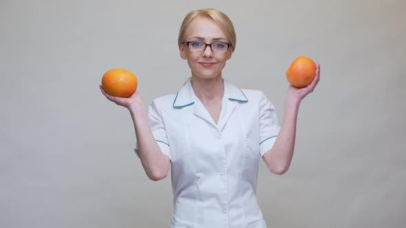 Thumbnail for Nutritionist Doctor Healthy Lifestyle Concept - Holding Organic Grapefruit Fruit