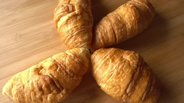 Thumbnail for Croissants Rotating in Wood Background