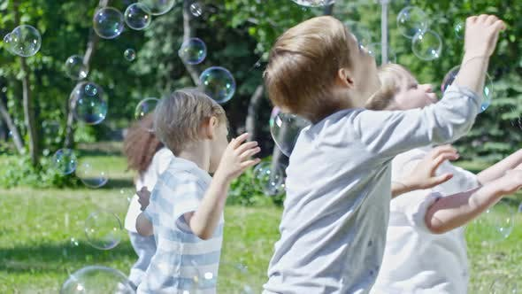 Cover Image for Joyous Kids Catching Soap Bubbles