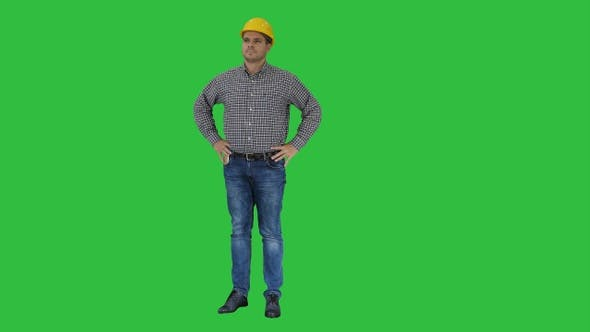 Thumbnail for Smiling construction worker in yellow helmet looking