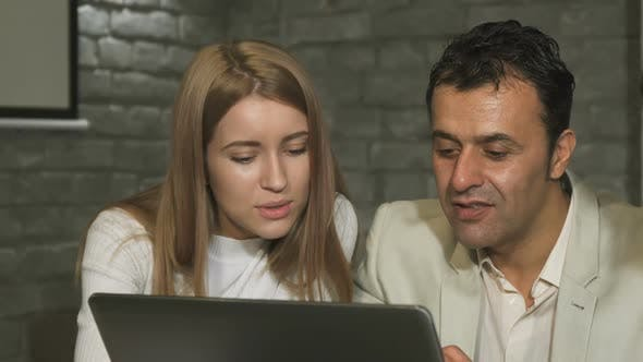 Thumbnail for Mature Businessman and His Young Colleague Working on the Laptop