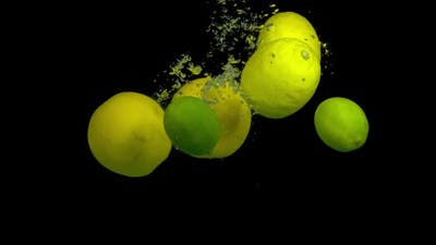 Citrus Fruit in Splash Water on a Black Background