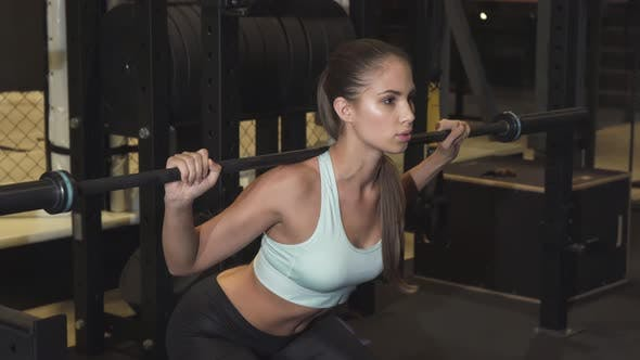 Thumbnail for Gorgeous Young Sportswoman Doing Squats at the Gym Studio