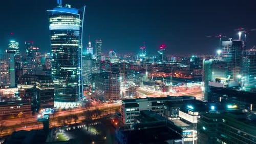 Aerial Hyperlapse of Warsaw Business Center at Night: Skyscrapers and Palace of Science and Culture