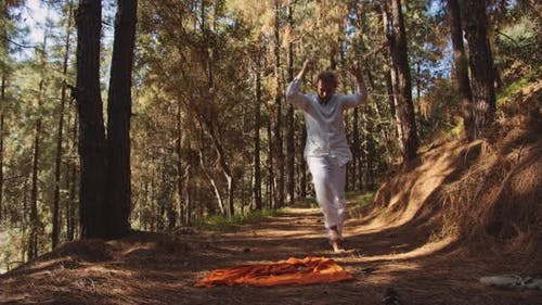 Young Man Dancing Wildly In Forest