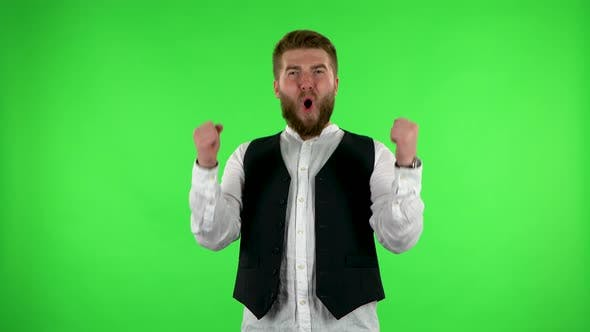 Thumbnail for Male Looking at the Camera, Then Celebrating His Victory Triumph on Green Screen.