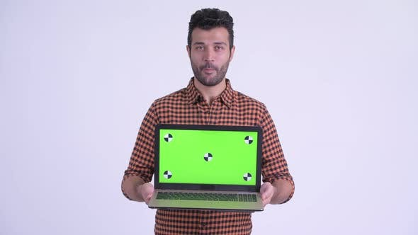 Thumbnail for Happy Bearded Persian Hipster Man Talking While Showing Laptop