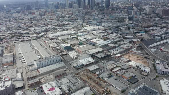 Thumbnail for AERIAL: Warehouse District in Los Angeles Slow Tilt Up Revealing Downtown LA Skyline