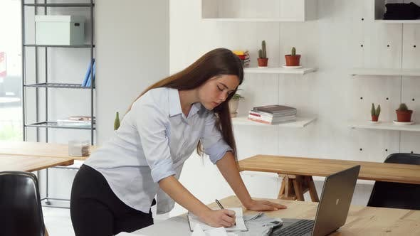 Thumbnail for Female Designer Busy at the Office, Working on Her Laptop