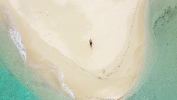 Cover Image for Young Woman Is Lying on the White Sand of a Tropical Island, Beach with Waves of Azure Sea