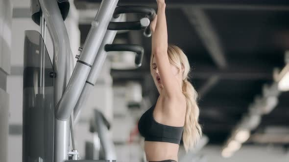 Thumbnail for Fitness Girl Doing Pull Ups Exercises in Modern Gym