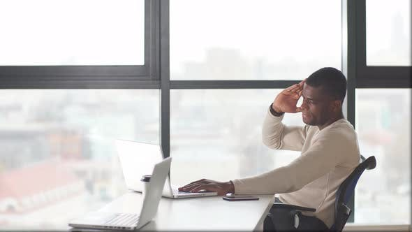 Thumbnail for African American Businessman in a Business Suit Working on Laptop