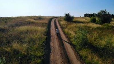 Top View on Runner Running Track Rural Landscape