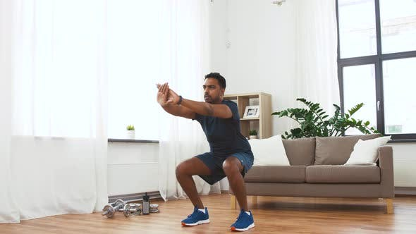 Thumbnail for Indian Man Exercising and Doing Squats at Home