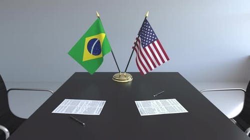 Flags of Brazil and the United States on the Table