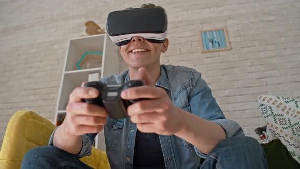 Thumbnail for Laughing Gamer in VR Headset