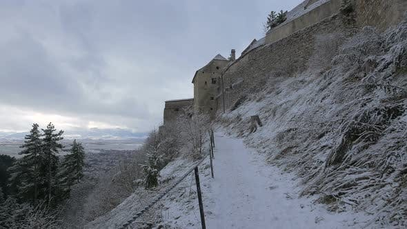 Alley along Rasnov Citadel on a winter day