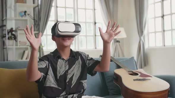 Asian Boy Explores Virtual Reality Device Interface