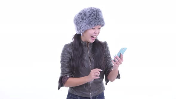 Cover Image for Happy Beautiful Asian Woman Using Phone and Getting Good News