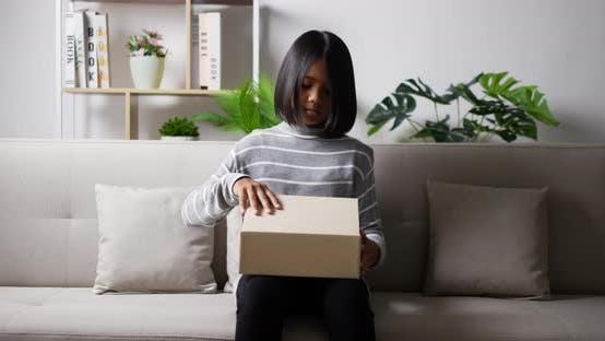 Teen girl opening gift box