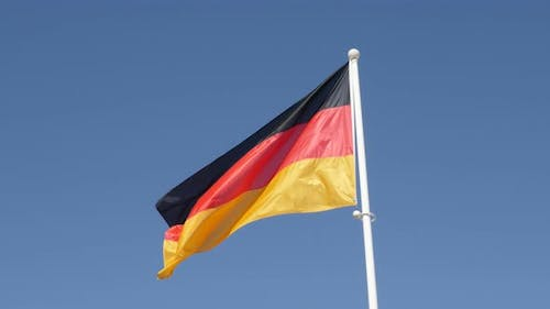 Recognizable   flag of Germany waving in front of blue sky 4K 2160p 30fps UHD footage - German natio