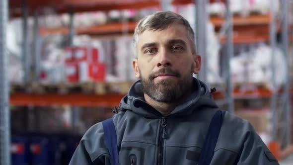 Cover Image for Male Warehouse Worker Posing