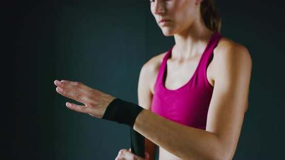 Thumbnail for Athletic Woman Training Kickboxing in the Gym