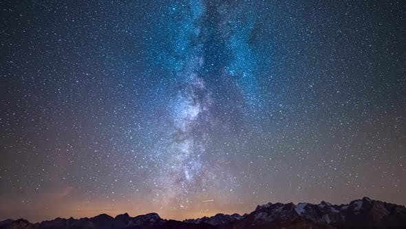 Time Lapse of the Milky way and the starry sky rotating over the majestic Alps