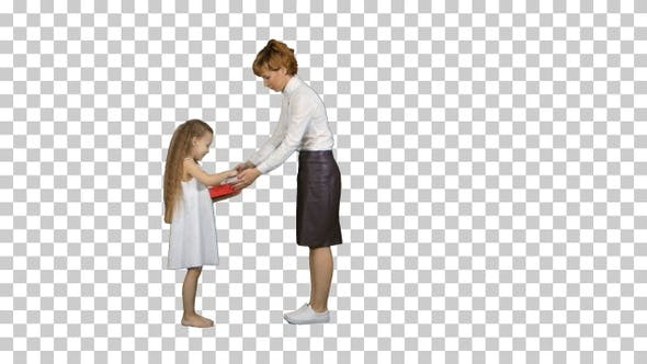Beautiful young mom giving a present to, Alpha Channel