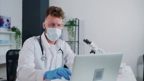 General Practitioner Working on Laptop