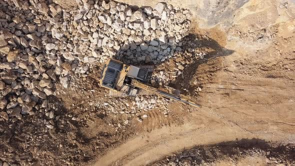 Thumbnail for Overhead View of Excavator in Open Air Quarry