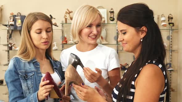 Thumbnail for Three Women Discussing Shoes in Shoe Shop