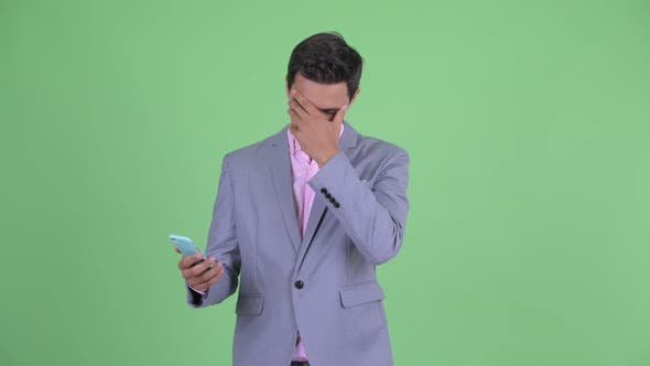 Thumbnail for Stressed Young Businessman Using Phone and Getting Bad News