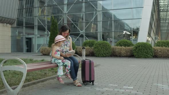 Thumbnail for Mother and Daughter Near Airport. Woman Hold Passports and Tickets in Hand. Child and Mom Vacation