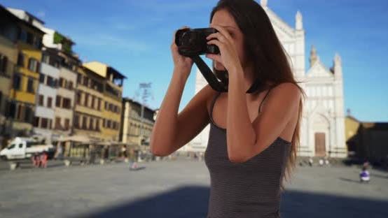 Thumbnail for Beautiful tourist woman with dslr camera taking photo in Santa Croce, Florence