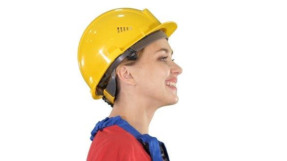 Cover Image for The young woman engineer with yellow safety helmet walking