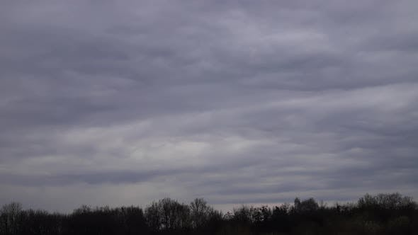 Time lapse: tense clouds flying in the sky blown by light wind