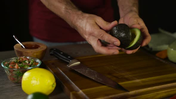 Thumbnail for Cutting Avocado on Wood Board