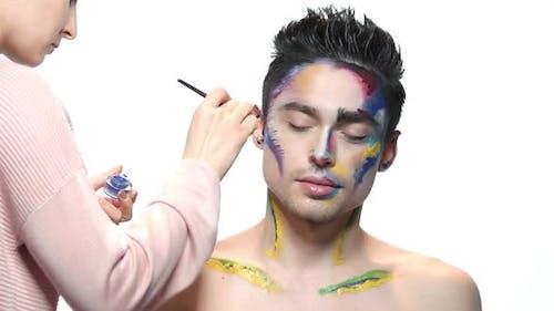 Visagist Applying Artistic Makeup.