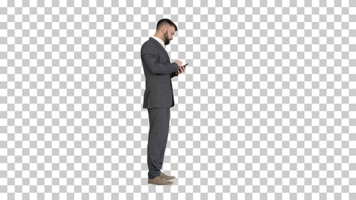 Turk business man using his phone, Alpha Channel