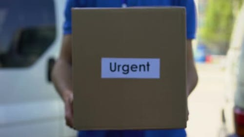 Urgent Delivery Courier in Uniform Holding Cardboard Box, International Shipping
