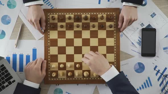Business Competitors Playing Chess Game, Company Taking Strategic Step on Market